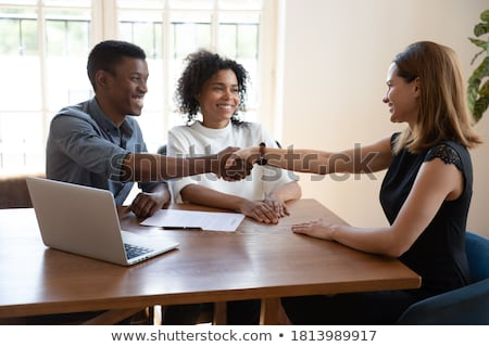 Real estate broker shaking hands with tenants Stock photo © Kzenon