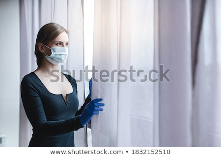 Unatkozik nő néz ki ablak fiatal Stock fotó © Kzenon