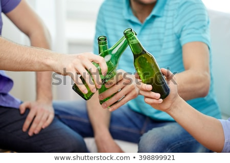 friends drinking non-alcoholic beer at home Stock photo © dolgachov