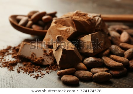 Chocolate and cocoa beans on color wooden background Stock photo © galitskaya