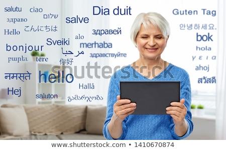 Idős nő fordító táblagép technológia online Stock fotó © dolgachov