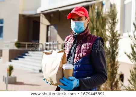 Koerier masker medische handschoenen voedsel vak Stockfoto © Illia