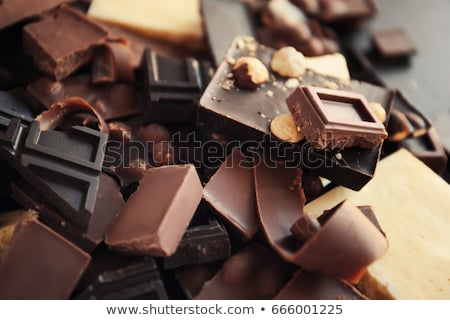 Heap of broken pieces of bitter or milk chocolate scattered on d Stock photo © joannawnuk
