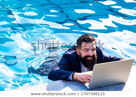 Laptop by swimming pool  Stock photo © mikdam