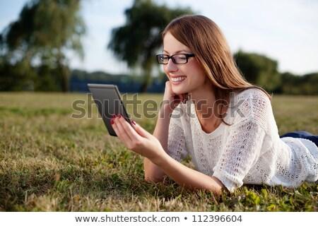 ebook · leitor · grama · portátil · eletrônico · livro - foto stock © bloomua