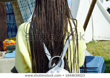 Girls weaving a braid outdoors Stock photo © pekour