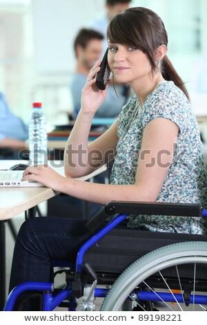 Genç kadın tekerlekli sandalye büro bilgisayar kadın kız Stok fotoğraf © photography33