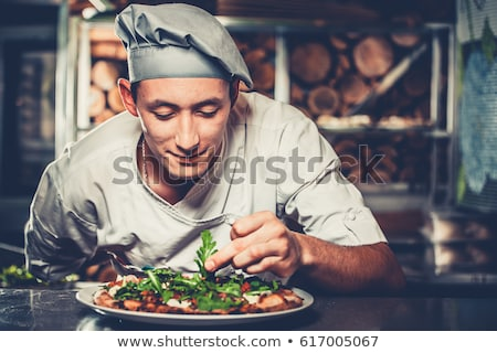 Młodych kucharz przygotowany włoski pizza kuchnia Zdjęcia stock © vladacanon