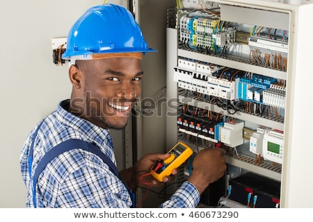 Young man with a multimeter Stock photo © photography33