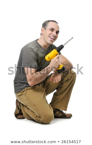 Handyman with power drill kneeling Stock photo © photography33