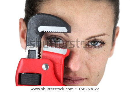 Close-up of brunette holding adjustable spanner Stock photo © photography33