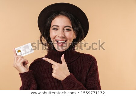 cute brunette woman in a sweater stock photo © imarin