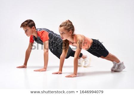 Beautiful girl doing push-ups Stock photo © vankad