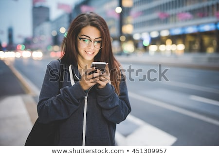 Brown-haired woman on phone Stock photo © photography33