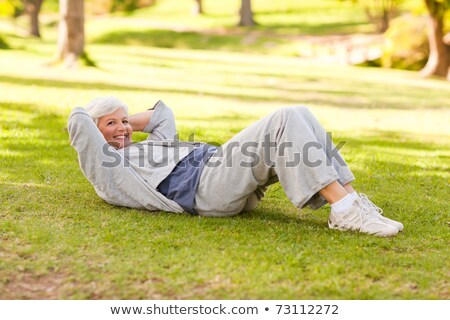 Retired woman doing her stretches Stock photo © wavebreak_media