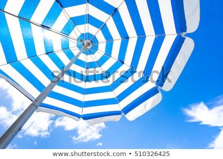 Közelkép napernyő kék ég esernyő kint vízszintes Stock fotó © zzve
