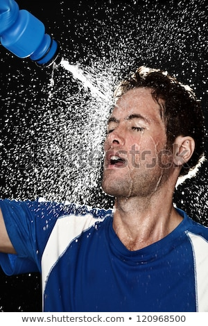 Sport fitness man. Young athletic man cooling himself Stock photo © HASLOO
