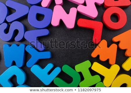 Colorato alfabeto blocchi legno isolato bianco Foto d'archivio © tashatuvango