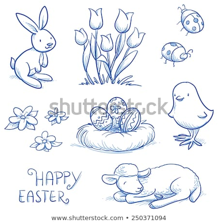 Easter funny bunnies with eggs and flowers stock photo © anmalkov