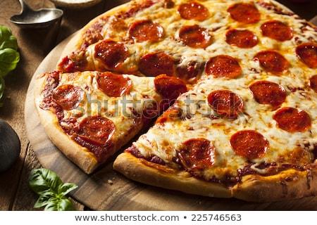 пепперони пиццы оливками черный таблице Сток-фото © vankad