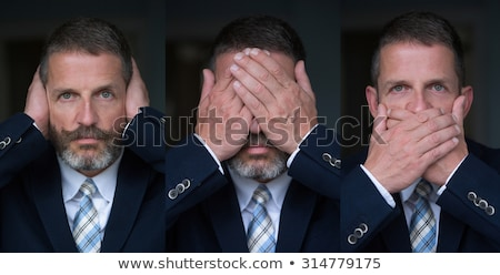 hear no evil   caucasian businessman posing stock photo © dgilder