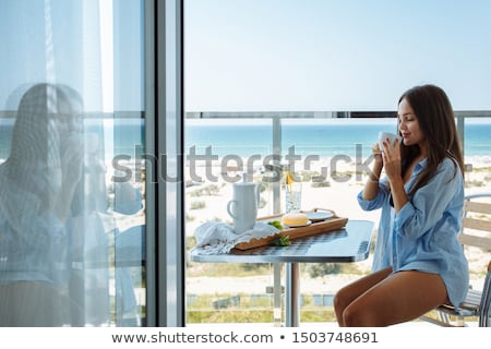breakfast on the seashore stock photo © tannjuska