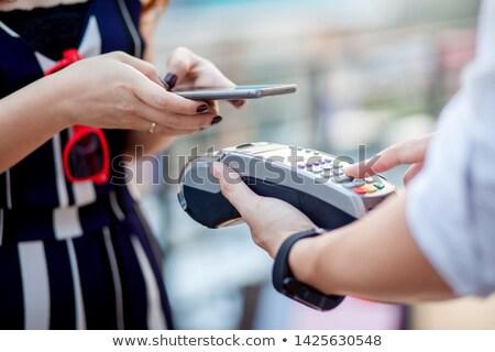 женщины кассир продажи столе кредитных карт машина Сток-фото © HighwayStarz