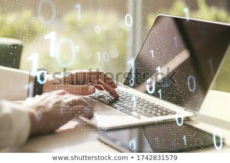 laptop with matrix background Stock photo © netkov1