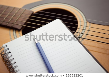 Notebook and pencil on guitar, Writing music Stock photo © eddows_arunothai