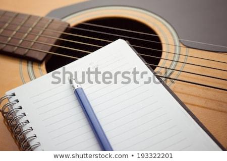 caderno · lápis · guitarra · escrita · música · papel - foto stock © eddows_arunothai