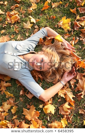 blue-eyed blond lies among yellow leaves 2 Stock photo © Paha_L