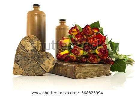 Pedra garrafa velho livro rosas vermelhas coração formas Foto stock © compuinfoto