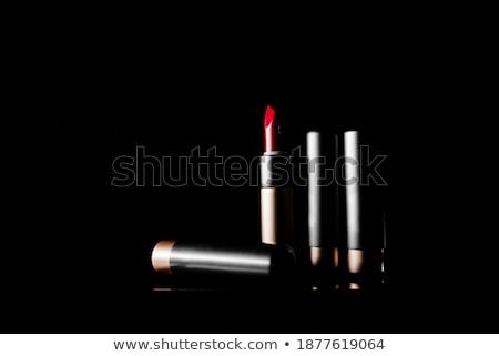Red melting lipstick isolated on black background Stock photo © artjazz