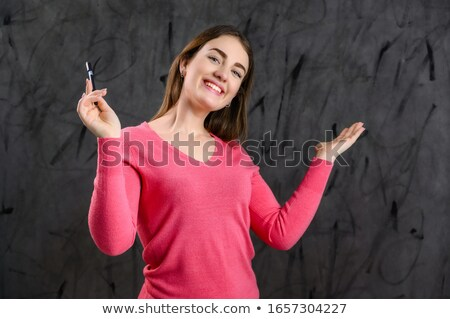 White haired senior with red sweater and suit Stock photo © ozgur