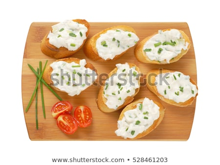 Tostado baguette cebollino rebanadas tazón Foto stock © Digifoodstock
