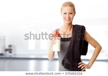 ストックフォト: フィットネス女性 · 立って · 首 · スタジオ