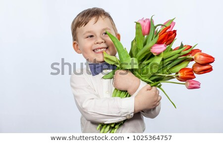 Young boy holding flowers smiling Stock photo © monkey_business