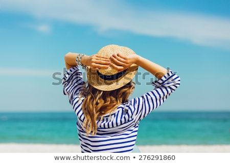 Woman wearing beachwear and sunglasses at tropical beach Stock photo © Kzenon