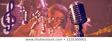 Happy musicians practicing on stage at nightclub Stock photo © wavebreak_media