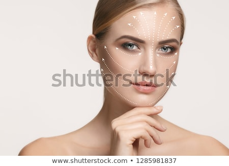Correction lines on woman face. Close up portrait. Stock photo © O_Lypa