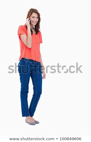 Shot jonge vrouw praten telefoon toevallig Stockfoto © deandrobot