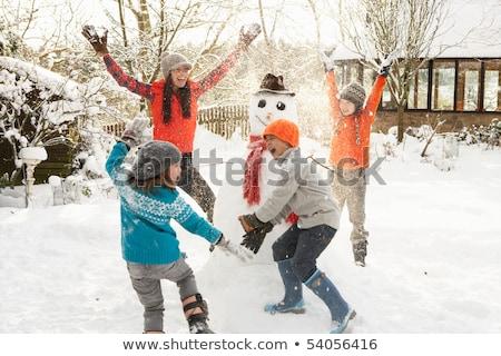 Family (4 people) in garden scene Stock photo © IS2