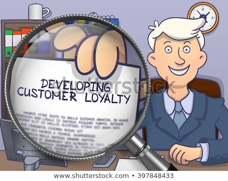 Ontwikkelen klant loyaliteit vergrootglas zakenman tonen Stockfoto © tashatuvango