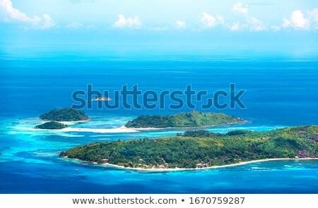 Kustlijn indian oceaan strand hemel wolken Stockfoto © serg64