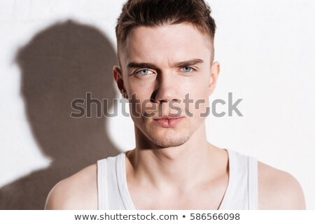 Portrait of blue-eyed young man Stock photo © IS2
