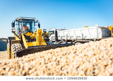 Construction workers doing earthworks with wheel loader Stock photo © Kzenon