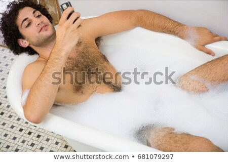Man using a cellular telephone in the bath Stock photo © IS2