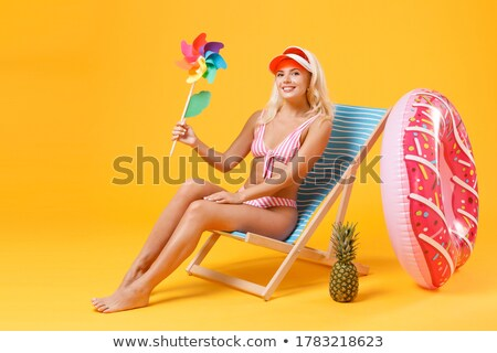 Person holding pinwheel in swimming pool Stock photo © IS2