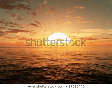 Sun setting over calm sea Stock photo © lightkeeper