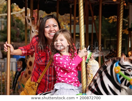 Mother and daughter on carousel Stock photo © IS2